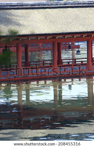 Itsukushima Shrine Reflected On The Surface Of The Water