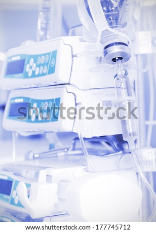 IV drip and modern medical equipment.  - stock photo