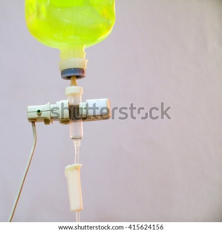 IV drip chamber, IV tubing, and IV bag of solution with copy space. - stock photo