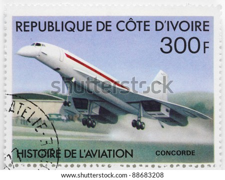 IVORY COAST - CIRCA 1977: A stamp printed in The Ivory Coast shows Aérospatiale-BAC Concorde a turbojet-powered supersonic passenger airliner with 144 seats, circa 1977. - stock photo