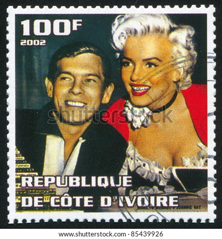IVORY COAST - CIRCA 2002: stamp printed by Ivory Coast, shows Marilyn Monroe, circa 2002. - stock photo