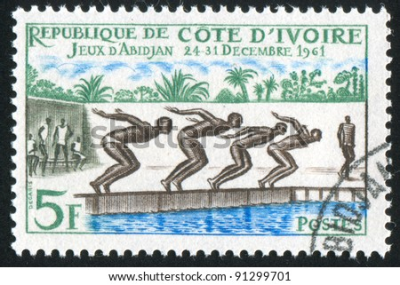 IVORY COAST CIRCA 1961: stamp printed by Ivory Coast, shows Swimming Race, circa 1961