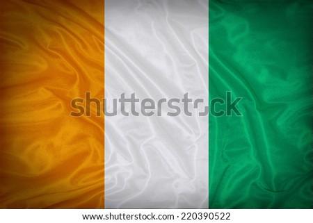 Ivory Coast flag pattern on the fabric texture ,vintage style - stock photo
