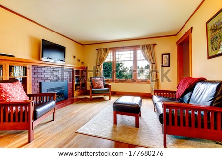 Ivory cozy living room  with leather couch, chair, rug. Open wall design with dining room - stock photo