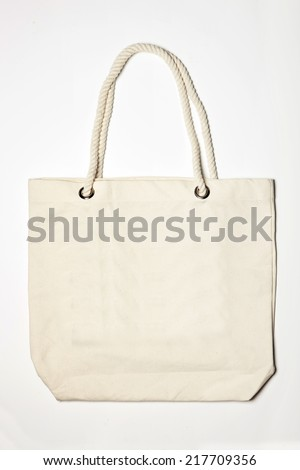 ivory eco bag, daily bag(linen fabric, canvas fabric) with string isolated white. - stock photo