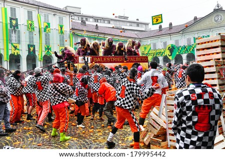IVREA - MARCH 3: Carnival of Ivrea. The battle of oranges. The throwing in the square of the Chess. On March 3, 2014 Ivrea, Italy. - stock photo