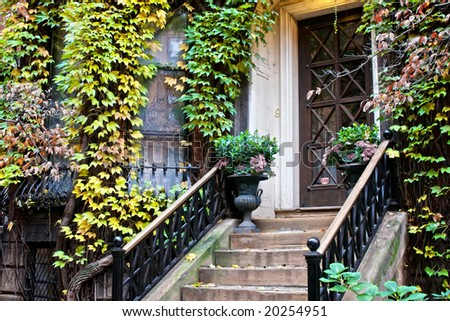 ivy plants and trees surround this old victorian doorway in beacon hill boston - stock photo