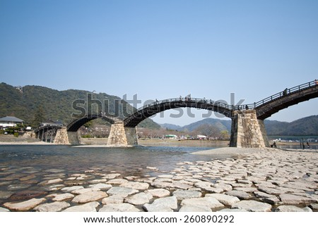 IWAKUNI, JAPAN - MARCH 23: The arched pedestrian Kintai Bridge over the Nishiki River and uinder the Iwakuni Castle, Yamaguchi Prefecture, Japan on March 23, 2014.