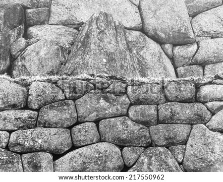 IWall in Inca city Machu Picchu at mist weather. It is a designated UNESCO World Heritage Site - Peru, South America (black and white) - stock photo