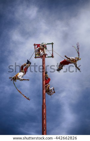 IXTAPA, MEXICO - DECEMBER 24, 2015: The Danza de los Voladores (Dance of the Flyers), or Palo Volador (pole flying), is an ancient Mesoamerican ceremony/ritual still performed today in Mexico. - stock photo