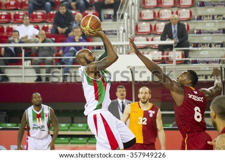 IZMIR DECEMBER 24: Pinar Karsiyaka's BRACEY WRIGHT shoots to the basket in Turkish Basketball League game between Pinar Karsiyaka 97-92 Galatasaray Odeabank on December 24, 2015 in Izmir - stock photo