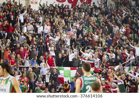 IZMIR - FEBRUARY 10: Pinar Karsiyaka's Fans are supporting in Eurocup game between Pinar Karsiyaka 109 - 66 Grissin Bon Reggio Emilia on February 10, 2016 in Izmir - stock photo
