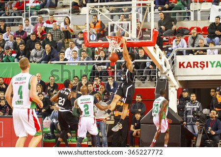 IZMIR JANUARY 20: Dolomiti Energia Trento's TRENT LOCKETT shoots to the basket in Eurocup game between Pinar Karsiyaka 79-85 Dolomiti Energia Trento on January 20, 2016 in Izmir - stock photo