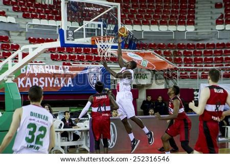 IZMIR - JANUARY 31: Pinar Karsiyaka's JUAN DIEGO TELLO PALACIOS layups to the basket in Turkish Basketball League game between Pinar Karsiyaka 82-76 Nsk Eskisehir Basket on January 31, 2015 in Izmir - stock photo