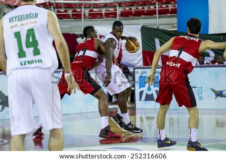 IZMIR - JANUARY 31: Pinar Karsiyaka's JUAN DIEGO TELLO PALACIOS posts up in Turkish Basketball League game between Pinar Karsiyaka 82-76 Nsk Eskisehir Basket on January 31, 2015 in Izmir - stock photo