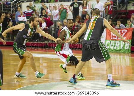 IZMIR - JANUARY 10: Pinar Karsiyaka's JUSTIN CARTER drives to the basket in Turkish Basketball League game between Pinar Karsiyaka 87-83 Akin Corap Yesilgiresun on January 10, 2016 in Izmir - stock photo