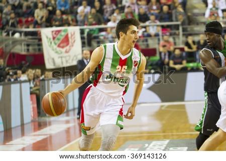 IZMIR - JANUARY 10: Pinar Karsiyaka's KENAN SIPAHI drives to the basket in Turkish Basketball League game between Pinar Karsiyaka 87-83 Akin Corap Yesilgiresun on January 10, 2016 in Izmir - stock photo