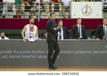 IZMIR   JUNE 16: Pinar Karsiyaka's  Coach UFUK SARICA standing near the bench in Turkish Basketball League game between Pinar Karsiyaka 91-88 Anadolu Efes on June 16, 2015 in Izmir - stock photo