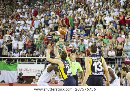 IZMIR - JUNE 06: Pinar Karsiyaka's KENNY KENNETH BENARD GABRIEL jumps for the jump ball in Turkish Basketball League game between Pinar Karsiyaka 82-64 Fenerbahce Ulker on June 06, 2015 in Izmir