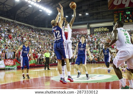 IZMIR - JUNE 14: Pinar Karsiyaka's KENNY KENNETH BENARD GABRIEL shoots to the basket in Turkish Basketball League game between Pinar Karsiyaka 71-65 Anadolu Efes on June 14, 2015 in Izmir - stock photo