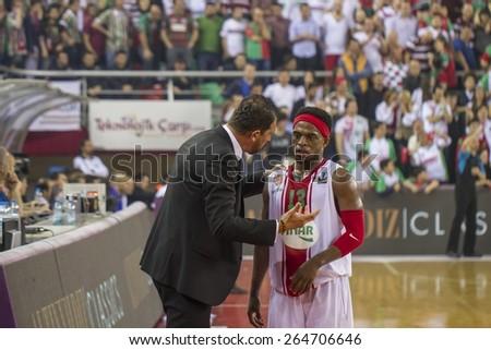 IZMIR   MARCH 25: Pinar Karsiyaka's Coach UFUK SARICA gives tactics to BOBBY ROBERT LEE DIXON in Eurocup game between Pinar Karsiyaka 74-75 Gran Canaria on March 25, 2015 in Izmir - stock photo