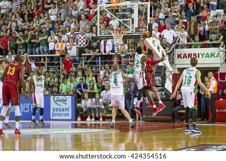 IZMIR - MAY 20: Pinar Karsiyaka's  KENNY KENNETH BENARD GABRIEL block the ball in Turkish Basketball League game between Pinar Karsiyaka 62-65 Galatasaray Odeabank on May 20, 2016 in Izmir - stock photo