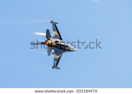 IZMIT, TURKEY - JUNE 28, 2014: Solo Turk demonstration team put on a show to public in Izmit city celebrating 93 years of liberation from enemy occupation. Airplane is a F-16 C Blok-40 fighter jet.