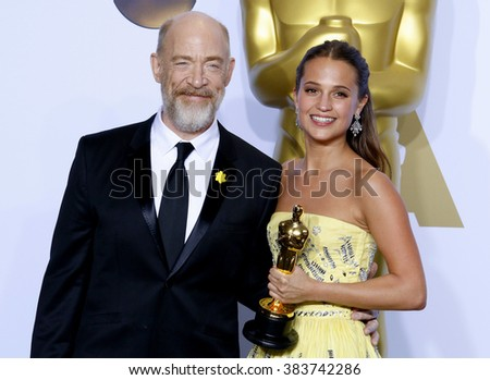 J.K. Simmons and Alicia Vikander at the 88th Annual Academy Awards - Press Room held at the Hollywood & Highland Center in Hollywood, USA on February 28, 2016.