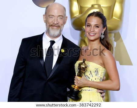 J.K. Simmons and Alicia Vikander at the 88th Annual Academy Awards - Press Room held at the Hollywood & Highland Center in Hollywood, USA on February 28, 2016. - stock photo