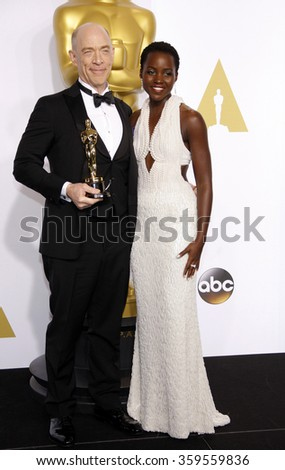 J.K. Simmons and Lupita Nyong'o at the 87th Annual Academy Awards - Press Room held at the Loews Hollywood Hotel in Los Angeles, USA on February 22, 2015. - stock photo