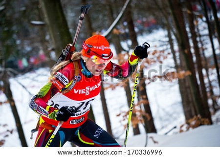 JABLONEC NAD NISOU, CZECH REPUBLIC - MARCH 22: Czech biathlete Gabriela Soukalova climbs the hill during Czech Biathlon Championships 2013, March 22, 2013 in Jablonec nad Nisou, Czech republic - stock photo