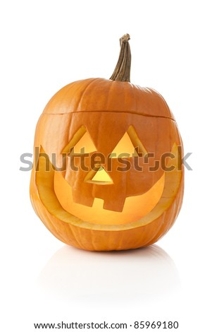 Jack O' lantern lit inside and isolated on white background - stock photo