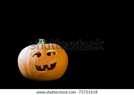 Jack-o-lantern with smiling face on a black background - stock photo