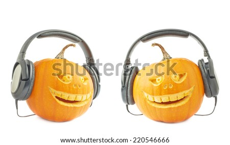 Jack-o'-lanterns orange halloween pumpkin head with the scary facial expression carved on it and the headphones on, isolated over the white background, set of two foreshortenings - stock photo