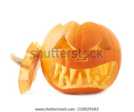 Jack-o'-lanterns orange halloween pumpkin head with the sharp teeth and scary facial expression, isolated over the white background - stock photo