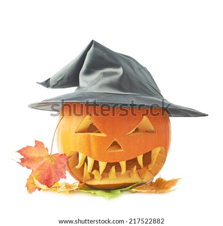Jack-o'-lanterns orange pumpkin head in a black pointed cone shaped wizard's hat over a pile of colorful maple leaves, composition isolated over the white background - stock photo