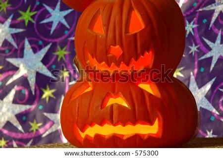 Jack O Lanterns - pumpkins carved into lighted jack-o-lanterns for Halloween. - stock photo