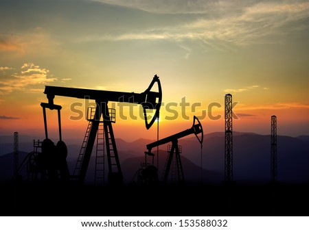 jack pump and oil field polluting the environment - stock photo