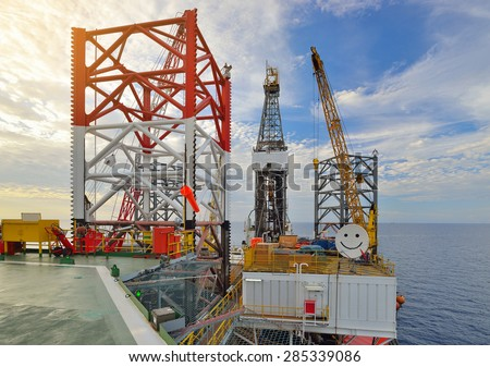 Jack up offshore oil rig in the sea in oil field industry. - stock photo