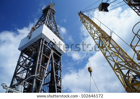 Jack Up Oil Rig (Drilling Rig) and Rig Crane - Offshore Drilling - stock photo