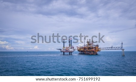 Jack Up Rig is working close to the oil processing platform