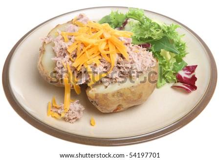 Jacket potato with tuna mayonnaise and cheese. - stock photo