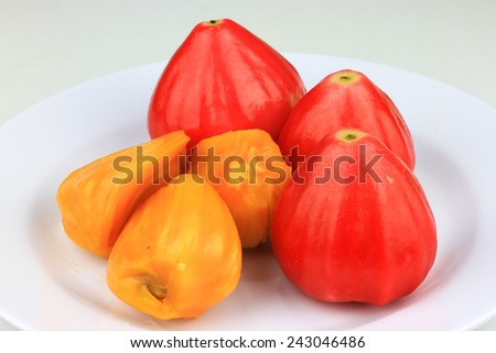 Jackfruit flesh and water apples in white plate - stock photo