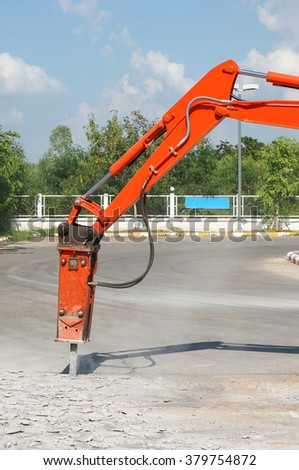 jackhammer and drilling caterpillar wheel vehicle on construction site - stock photo