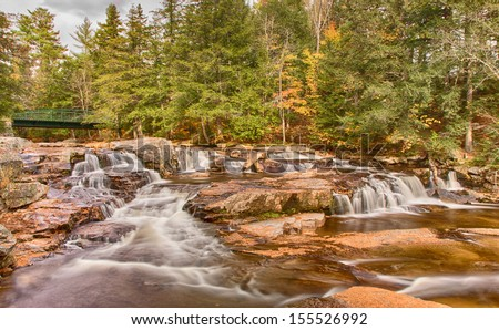 Jackson Falls with Autumn color, New Hampshire. - stock photo