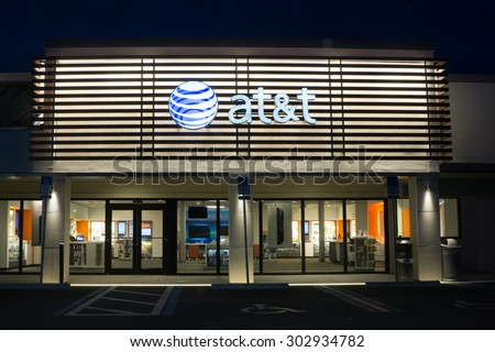 JACKSONVILLE, FLORIDA, USA - AUGUST 1, 2015: An AT&T Mobility store at night. AT&T Mobility is the second largest wireless telecommunications provider in the United States and Puerto Rico. - stock photo