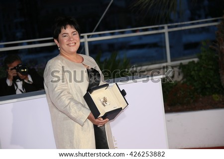 Jaclyn Jose poses  the Palme D'Or Winner Photocall during the 69th annual Cannes Film Festival at the Palais des Festivals on May 22, 2016 in Cannes, France. - stock photo