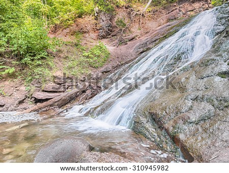 Jacobs Creek Falls, on M-26 between Eagle River and Eagle Harbor, Michigan. - stock photo
