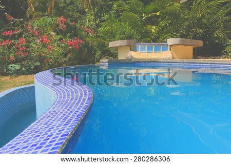 Jacuzzi and infinity pool - stock photo