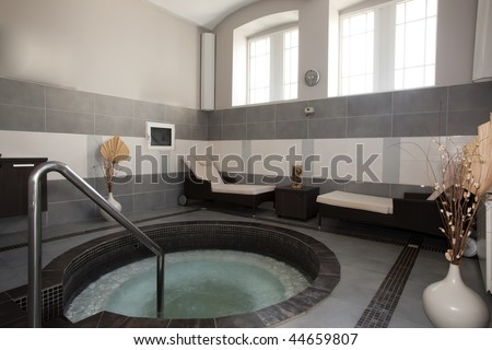 jacuzzi bath in spa center - stock photo